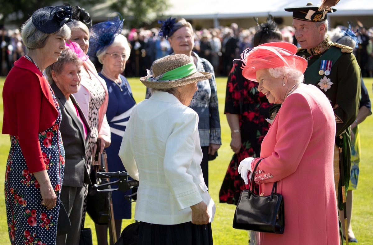 The Queen talks to her guests at the Garden Party on 3 July 2019. The Captain-General, in Court Dress, is in attendance