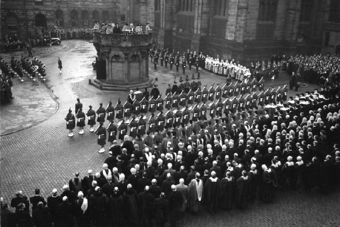 The Public Proclamation of Accession of Queen Elizabeth II on 8 February 1952 at the Mercat Cross, Edinburgh. The Royal Company are to the right of the Cross.