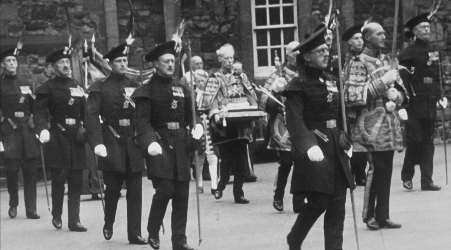 The Lord Lyon, King of Arms and other Heralds carrying the Honours prior to the procession to St Giles' Cathedral for the Service of Thanksgiving in 1953. The escort was provided by the Royal Company of Archers.